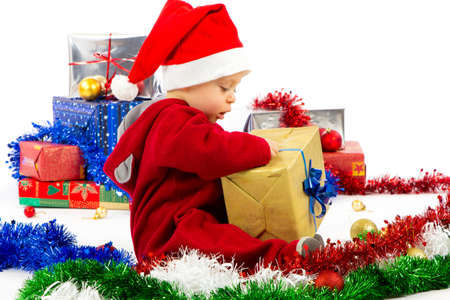 christmas baby: Santa s little helper baby with christmas gifts with white background Stock Photo