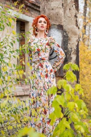 non urban 1: beautiful readhead woman in the autumn forest