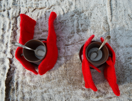 brich: Two cups of tea and knitted mittens Stock Photo