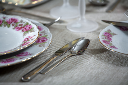 Beautifully decorated table with with spoon and fork