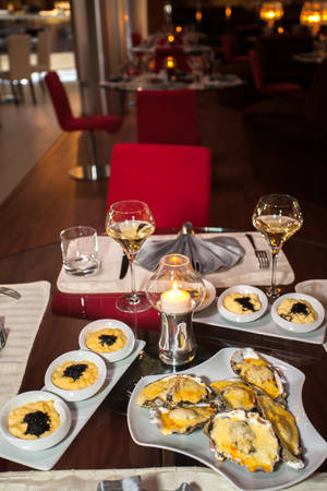 expensive food: beautiful decorated tables in expensive restaurant with food