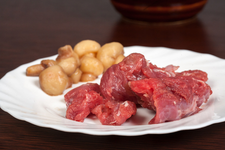 stewing: meat on a white plate on the table