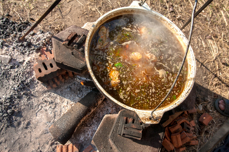 soup kettle: Cooking soup on picnic in a kettle