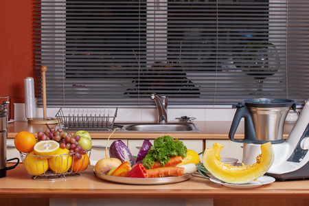Vegetables and fruits ready to make fresh juice in the kitchen Stock Photo