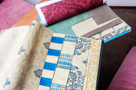 Wallpaper and fabric swatches, books with samples Stock Photo