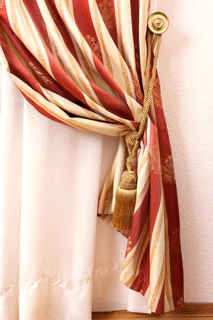 yellow tassel: Curtain with an ornament in the modern apartment Stock Photo