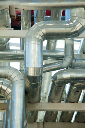 metal pipes: a lot of Metal pipes of metallurgical plant closeup Stock Photo
