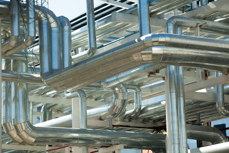 a lot of Metal pipes of metallurgical plant closeup Stock Photo
