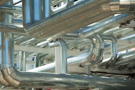 smokestacks: a lot of Metal pipes of metallurgical plant closeup Stock Photo