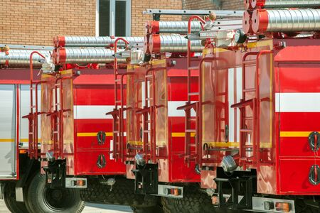 autotruck: four red Fire trucks in a yard