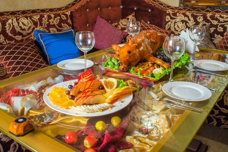 pig roast: Roasted pig on rich table in eastern restaurant