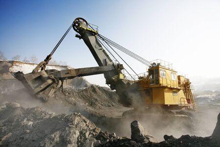 worksite: big mine excavator at the worksite. Winter