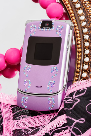 recieve: isolated pink mobile phone decorated with rhinestones