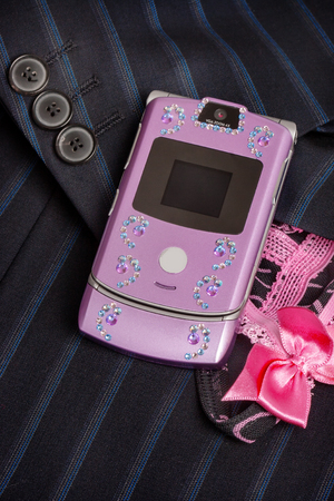 doublet: isolated pink mobile phone decorated with rhinestones
