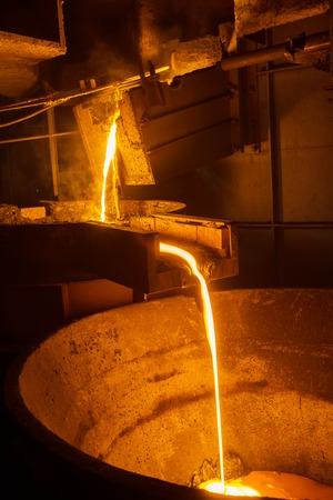 steel plant: very hot steel pouring in steel plant