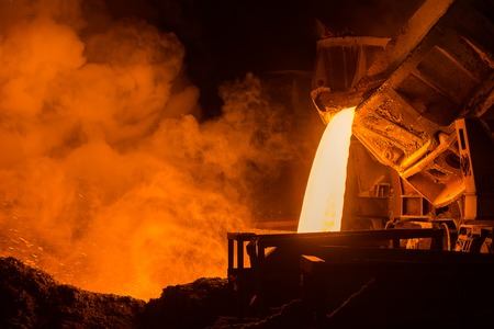 red hot iron: very hot steel pouring in steel plant