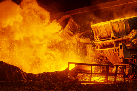 steel: very hot steel pouring in steel plant