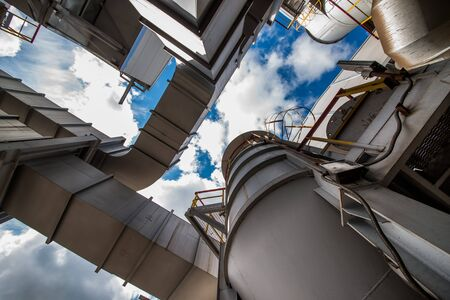 Ferroalloy plant and blue sky with clouds Imagens