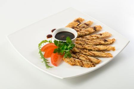 souse: Sliced fish sticks and souse on plate isolated on white background Stock Photo