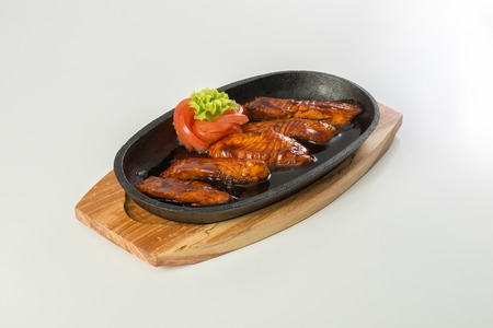 rosmarin: Salmon steak in the frypan on a white background