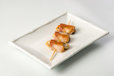 octopus: Seafood on stick on a white background