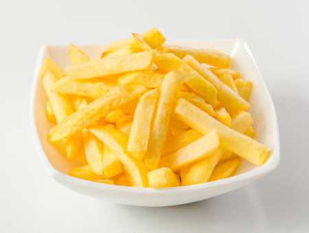 french fries plate: French fries, on plate on a black background Stock Photo
