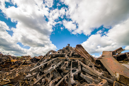 salvage yards: Garbage dump of metal and iron. Blue sky Stock Photo