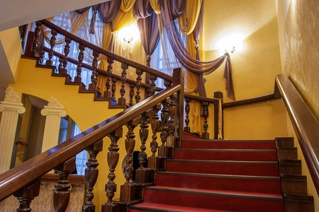A classic wooden staircase in a luxury home