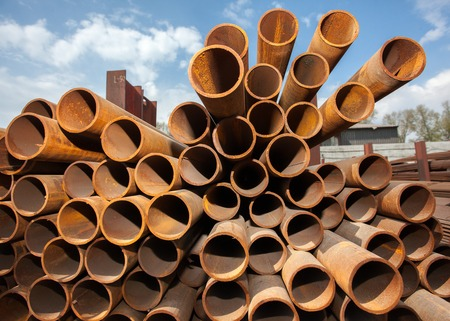 burnish: Stack of metal pipes for heavy industry Stock Photo