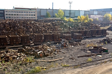 dump yard: A pile of scrap metal in the back yard of the factory Stock Photo
