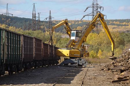 scrapyard: Two yellow excavators working on the scrapyard
