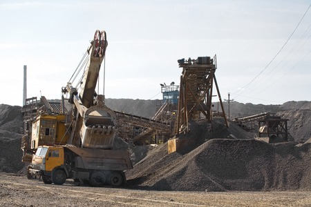 gaining: Excavator bucket gaining rubble at the plant
