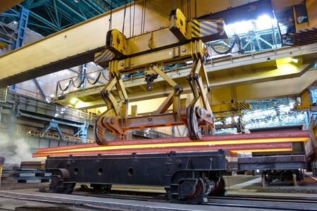 prefabricate: Process of manufacturing metal. Crane carries metal at the plant