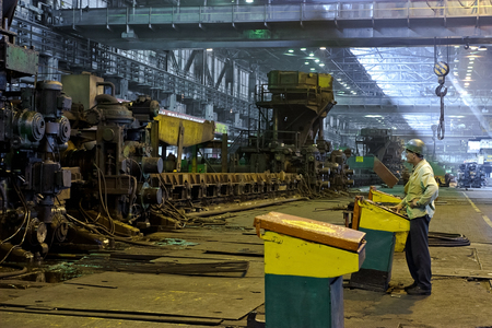 cater: Workers cater for equipment in the steel producing workshop Stock Photo