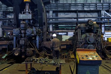 Worker cater for equipment in the steel producing workshop