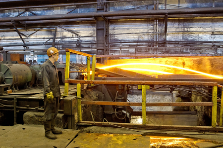 cater: Worker cater for equipment in the steel producing workshop