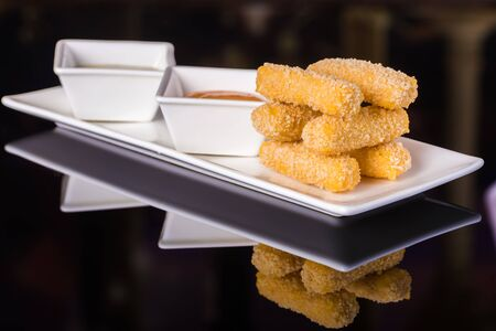chese: Fried cheese balls with sauces on th table