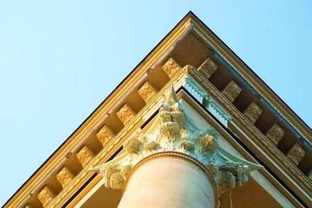 roman column: House with Roman column detail over blue sky view Stock Photo