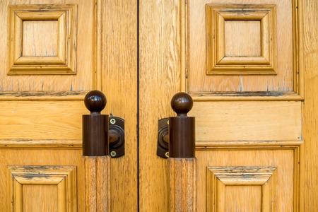 handles: two wooden door metal handles Stock Photo