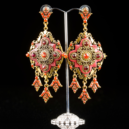 jewelry: Jewelry filigree earrings with shiny gems on black background