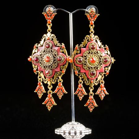 jewelry: Jewelry filigree earrings with shiny gems on black background