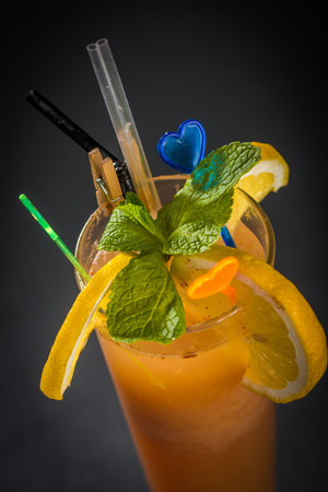 drinking straw: Glass of orange juice with mint and drinking straw Stock Photo