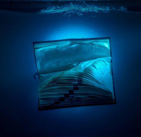 under water: diary under water in aquarium on blue background