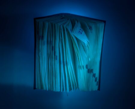 diary background: diary under water in aquarium on blue background