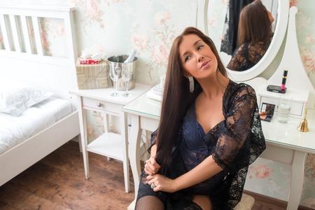 boudoir: Seductive brunette girl in underwear near vintage boudoir in the room