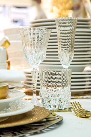 elegantly: Elegantly holiday dinner table with beautiful dishes close-up