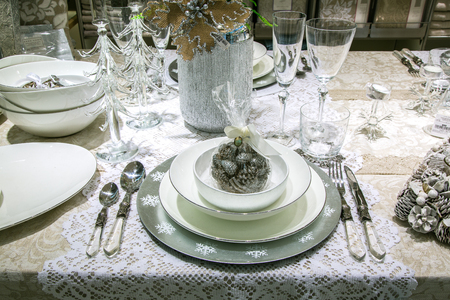 Elegant Christmas table setting close-up with cones