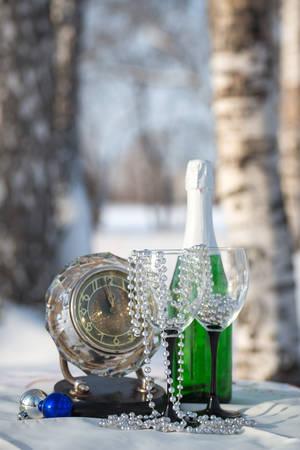 birchwood: Champagne, glasses, watch  in the winter birchwood