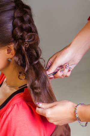 hair curler: Woman curling hair with electric hair curler Stock Photo
