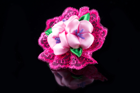hair band: Pink flower hair band handmade decoration on black background Stock Photo